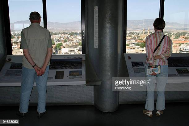 Tourists view Turkish northern Cyprus from Shacolas Tower in downtown Greek Nicosia near the Green Line separating the northern Turkish side and the...