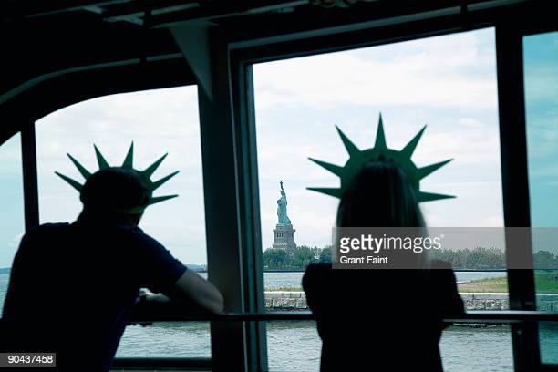 Tourists viewing Statue of Liberty from ferry
