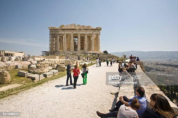 Tourists viewing the Parthenon under restoration