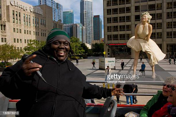 Tourists visit a 26foot tall sculpture of Marilyn Monroe on October 17 2011 in Chicago Illinois The sculpture by Seward Johnson is displayed on...