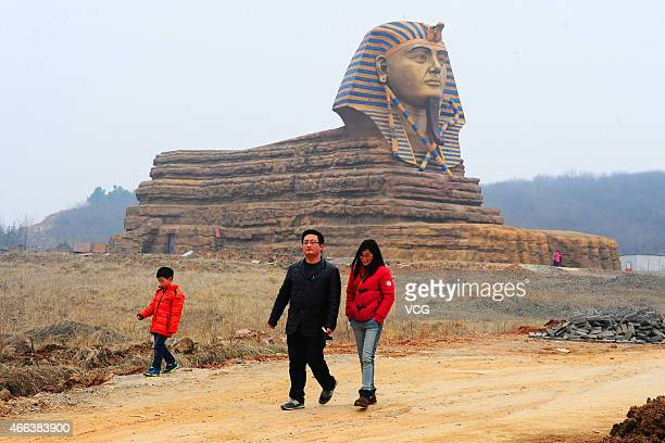 Tourists visit a full-size replica of the Great Sphinx on March 14, 2015 in Chuzhou, Anhui province of China. The replica has been built as part of...