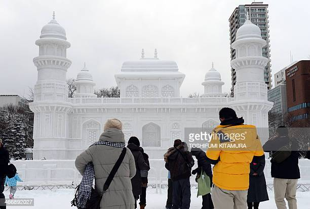Tourists visit a large snow sculpture called the 'Tomb of ItmadudDaula' of India during the 65th annual Sapporo Snow Festival on February 5 2014 The...