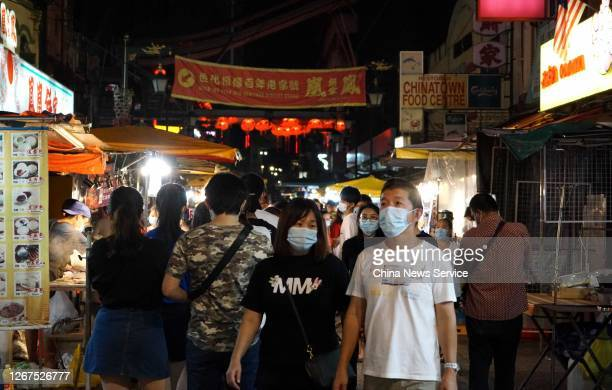 Tourists visit a night market at the Petaling Street on AUGUST 20, 2020 in Kuala Lumpur, Malaysia.