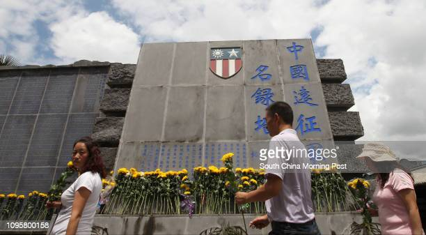 Tourists visit a World War II cemetery for soldiers who fought in Yunnan and southeast Asia in Tengchong southwest China's Yunnan province on Aug 13...