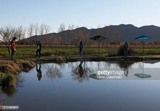 Tourists visit an artificial lake created in the Samalayuca desert Ciudad Juarez mujnicipality Chihuahua state Mexico on March 14 2020 April 22 2020...