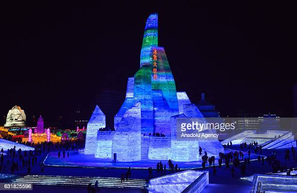 Tourists visit an illuminated ice castle during the 33rd Harbin International Ice and Snow Festival at Harbin Ice And Snow World in Harbin China on...