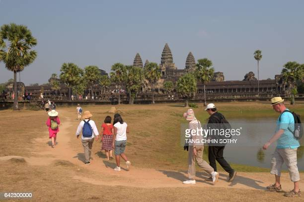 Tourists visit Angkor Wat temple in Siem Reap on February 17 2017 Millions of tourists visit Cambodia's famed Angkor temple complex every year / AFP...