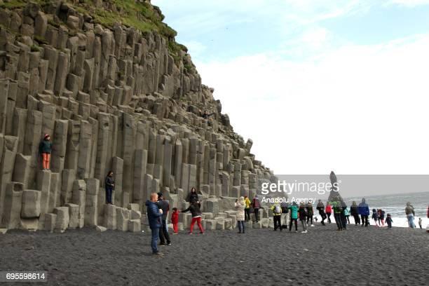 Tourists visit Black beach in Vik Iceland on June 13 2017