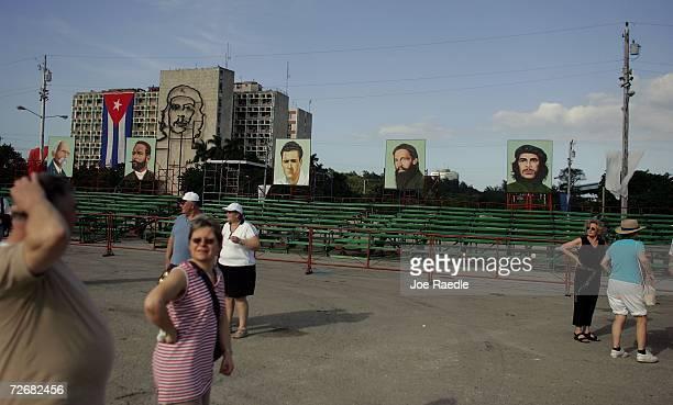 Tourists visit Havana's Revolution Square where paintings of historic Communist leaders line the bleachers November 30 2006 in Havana Cuba The 50th...