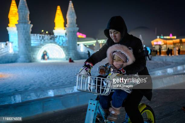 Tourists visit Ice and Snow World part during the 36th Harbin Ice and Snow Festival in Harbin Heilongjiang province Harbin International Ice and Snow...