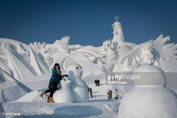 Tourists visit ice sculpture during the 36th Harbin Ice and Snow Festival in Harbin Heilongjiang province Harbin International Ice and Snow Sculpture...