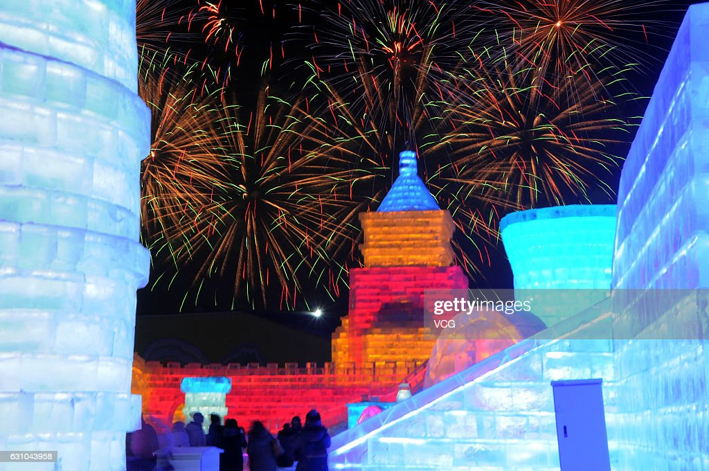 Tourists visit ice sculptures illuminated by coloured lights during the opening ceremony of the 18th Harbin Ice And Snow World as part of the 33rd Harbin International Ice and Snow Festival on January 5, 2017 in Harbin, China. The Festival, established in 1985, is held annually from January 5 and lasts for over one month.