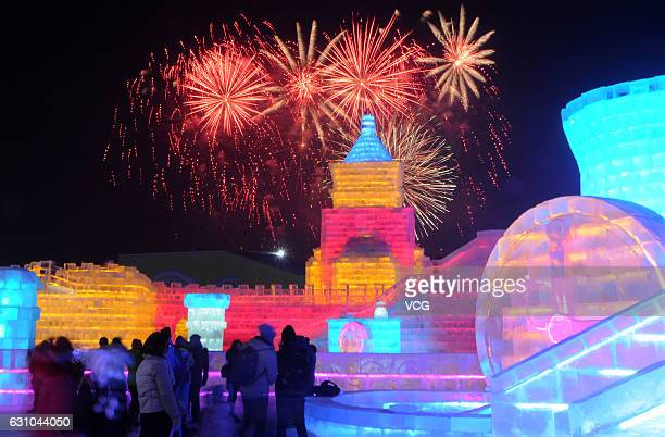 Tourists visit ice sculptures illuminated by coloured lights during the opening ceremony of the 18th Harbin Ice And Snow World as part of the 33rd...