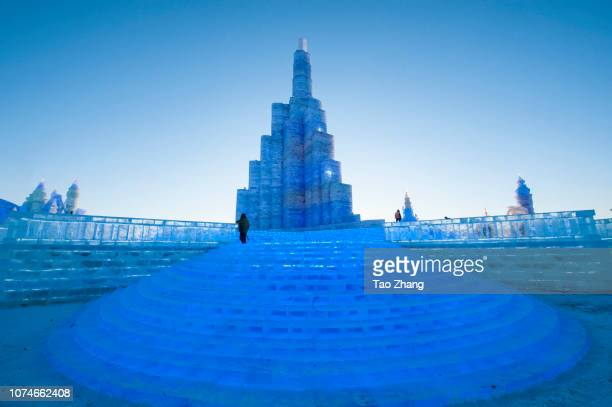 Tourists visit illuminated ice sculptures at Ice and Snow World park on December 23 2018 in Harbin China The Ice and Snow World Park will host the...