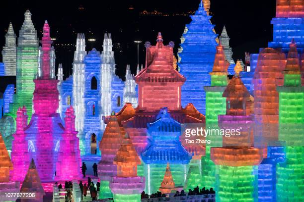 Tourists visit illuminated ice sculptures at Ice and Snow World park on January 5 2019 in Harbin China The Ice and Snow World Park will host the 35th...