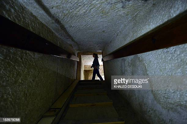 Tourists visit inside the pyramid of Khafre in Giza southwest of central Cairo on October 11 after the reopening of the site and six graves of...