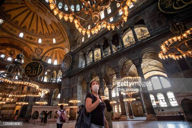Tourists visit Istanbul's famous Hagia Sophia on July 02 2020 in Istanbul Turkey Turkey's Council of State will begin a review today of the...