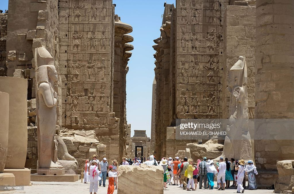 Tourists visit Karnak temple in Luxor, a town 700 kilometres (435 miles) south of the Egyptian capital, Cairo, on June 11, 2015. The ancient temple was open as usual despite a foiled suicide and gun attack on the world-famous site that police said would have been a 'massacre'.