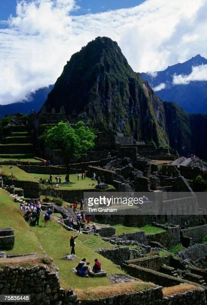 Tourists visit Machu Picchu ruins of Inca citadel in Peru South America