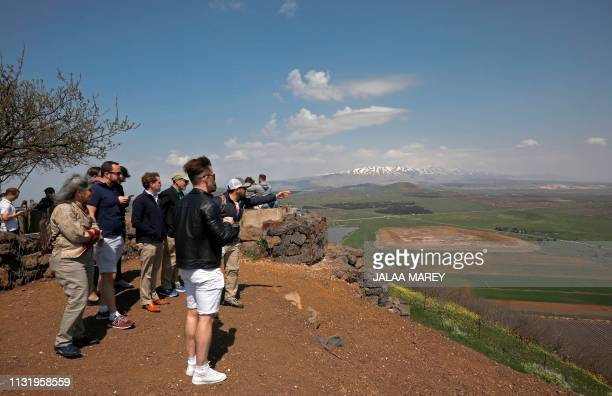 Tourists visit Mount Bental in the Israeli-annexed Golan Heights on March 22, 2019. - The Syrian government condemned US President Donald Trump's...