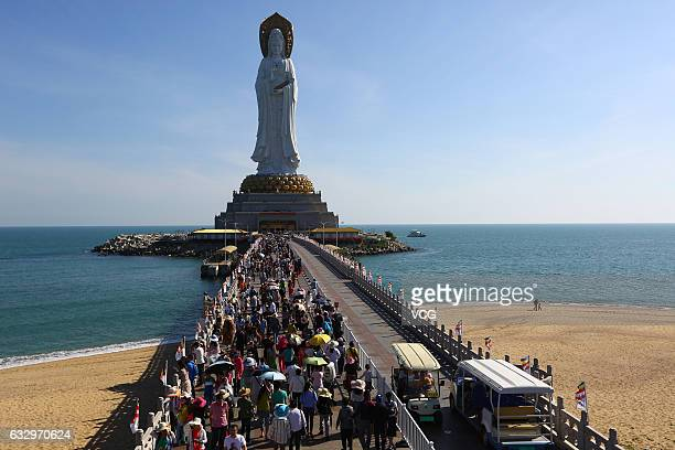 Tourists visit Nanshan Cultural Tourism Zone on the Chinese Lunar Year on January 28 2017 in Sanya Hainan Province of China Nanshan Cultural Tourism...