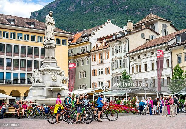 Tourists visit on June 26 2014 the city of Bolzano /Bozen in South Tyrol Italy's Germanspeaking northern region Upcoming Scotland's independence...