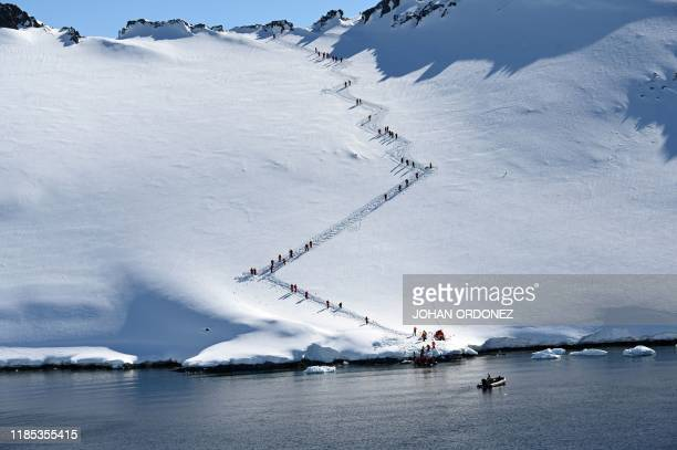 TOPSHOT Tourists visit Orne Harbur in South Shetland Islands Antarctica on November 08 2019