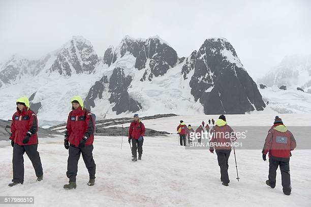 Tourists visit Pleneau Island, Antarctica, on March 03, 2016. The Antarctic tourism industry is generally considered to have begun in the late 1950s...