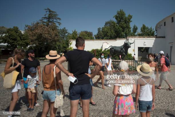 Tourists visit Ronda on July 29, 2021. - The prospects for Spain's tourism sector are getting bleaker, with European reservations slowing over...