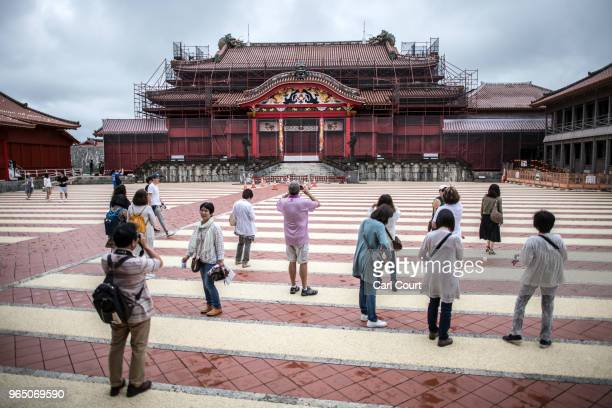 Tourists visit Shuri Castle on June 1 2018 in Naha Japan Like the rest of Japan the southern island of Okinawa has seen a recent surge in tourist...