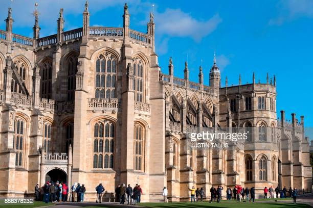 Tourists visit St George's Chapel in the afternoon sunshine inside the grounds of Windsor Castle in Windsor west of London on December 8 2017...