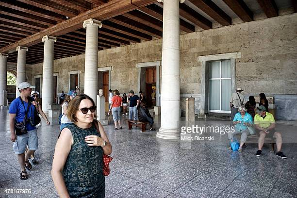Tourists visit the Ancient Agora archeological site on June 23 2015 in Athens Greece Greece this week offered a series of measures including multiple...