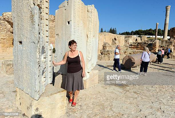 Tourists visit the ancient city of Carthage near Tunis on October 31 one day after a suicide bomber blew himself up in failed attack at a fourstar...