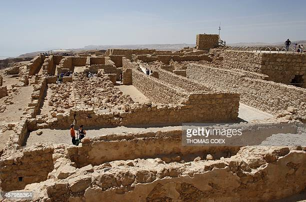 Tourists visit the ancient hilltop fortress of Masada in the Judean desert on April 21 2014 Masada a ruined desert fortress steeped in myth symbolism...