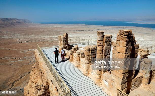 Tourists visit the ancient hilltop fortress of Masada in the Judean desert on May 16 2017 Masada was the mountain fortress constructed by King Herod...