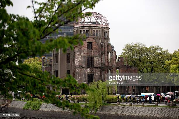 Tourists visit the Atomic Bomb Dome on April 21 2016 in Hiroshima Japan The nearby park museum and the dome are dedicated to the legacy of Hiroshima...