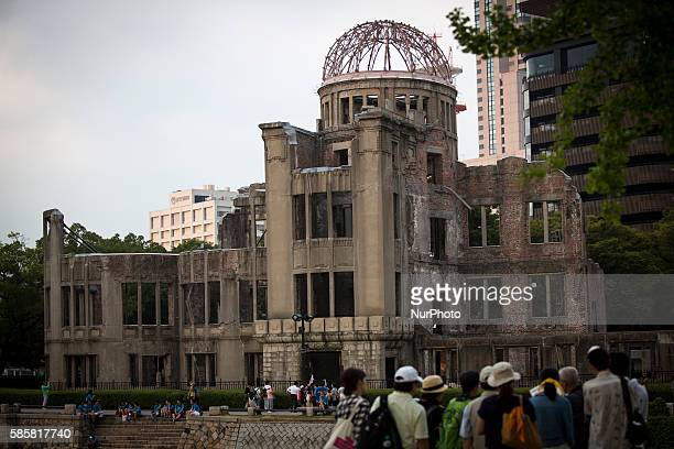 Tourists visit the Atomic Bomb Dome two days prior to 71st anniversary of the bombing in Hiroshima at the Hiroshima Peace Memorial Park western Japan...