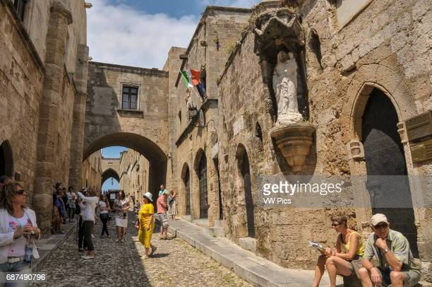 Tourists visit the Avenue of the Knights in the medieval Old Town of Rhodes