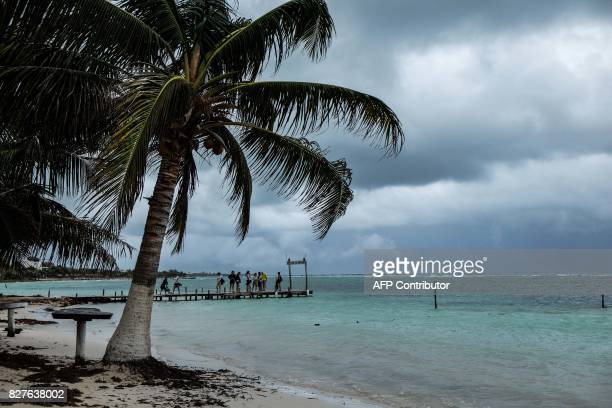 Tourists visit the beach in Mahahual Quintana Roo State on August 8 2017 after tropical storm Franklin made landfall on Mexico's Yucatan peninsula...