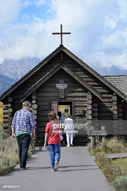 Tourists visit the Chapel of Transfiguration in Grand Teton National Park in Wyoming. The small log chapel was built in 1925 by the St. John's...