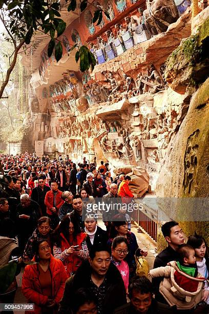 Tourists visit the Dazu Rock Carvings to celebrate Chinese lunar new year on February 10 2016 in Chongqing China