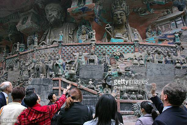 Tourists visit the Dazu Stone Carving on March 13 2005 in Chongqing China The Dazu Stone carving located 160 kilometers northwest of Chongqing is one...