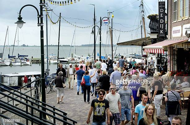 Tourists visit the Dyke in Volendam on July 30 2013 The village attracts every year many tourists from all over the world AFP PHOTO / ANP / OLAF...