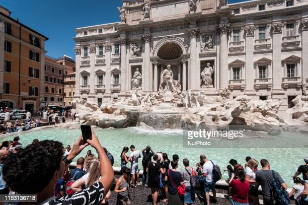 Tourists visit the Fontana di Trevi as temperatures reach 35 degrees Celsius in the center of Rome, on July 1, 2019 in Rome, Italy.