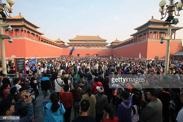 Tourists visit the Forbidden City during the National Day holiday on October 4 2015 in Beijing China Many scenic spots in China have welcomed the...