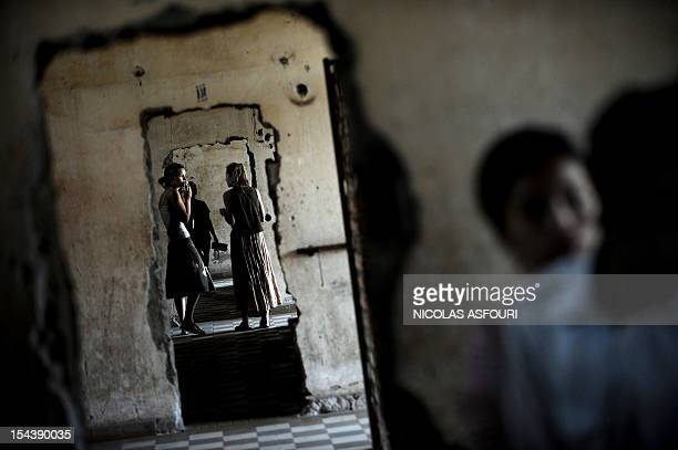 Tourists visit the genocide museum at Tuol Sleng the former prison S21 used by the Khmer Rouge to imprison and torture thousands of Cambodians during...