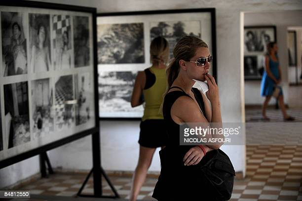 Tourists visit the genocide museum at Tuol Sleng, the former prison S-21 used by the Khmer Rouge to imprison and torture thousands of Cambodians...