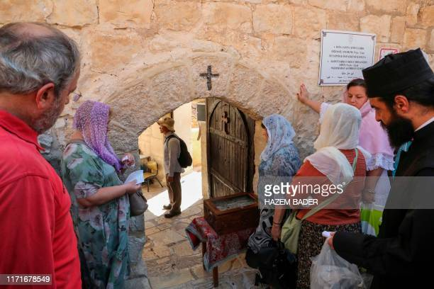 Tourists visit the Greek Orthodox monastery of St Sabbas, also known as Mar Saba, overlooking the Kidron Valley in the West Bank south of the...
