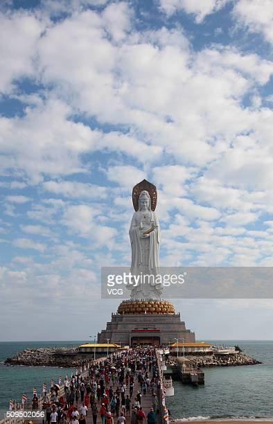 Tourists visit the Guan Yin of the South Sea during the Spring Festival holiday on February 10 2016 in Sanya Hainan Province of China The festival of...
