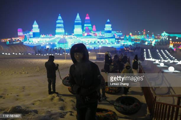 Tourists visit the Harbin Ice and snow world on January 4 2020 in Harbin Heilongjiang Province China The Ice and Snow World Park will host the 36th...
